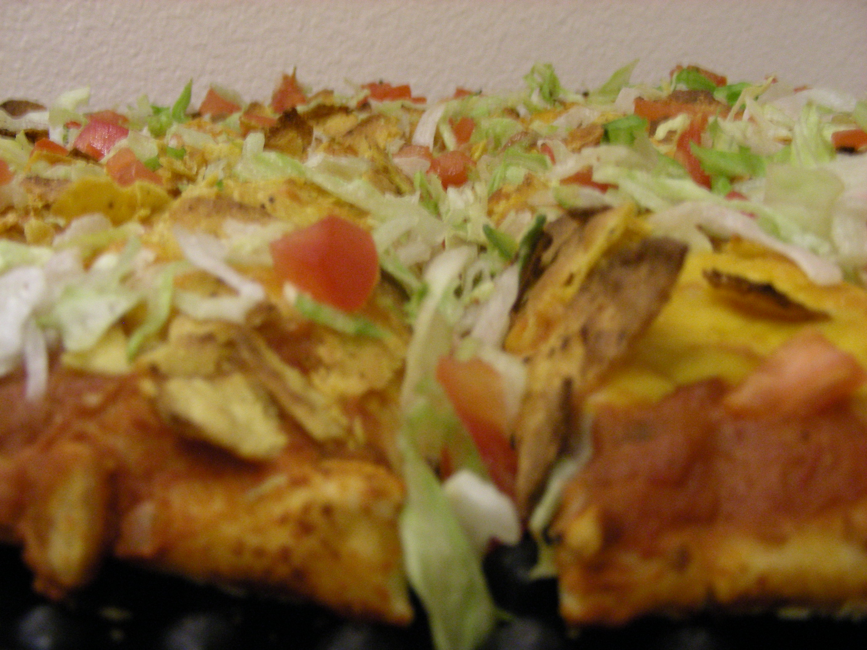 Lotta Tostada Pizza (Refried Beans, Cheddar Cheese, Lettuce, Diced Tomatoes, and Salsa)