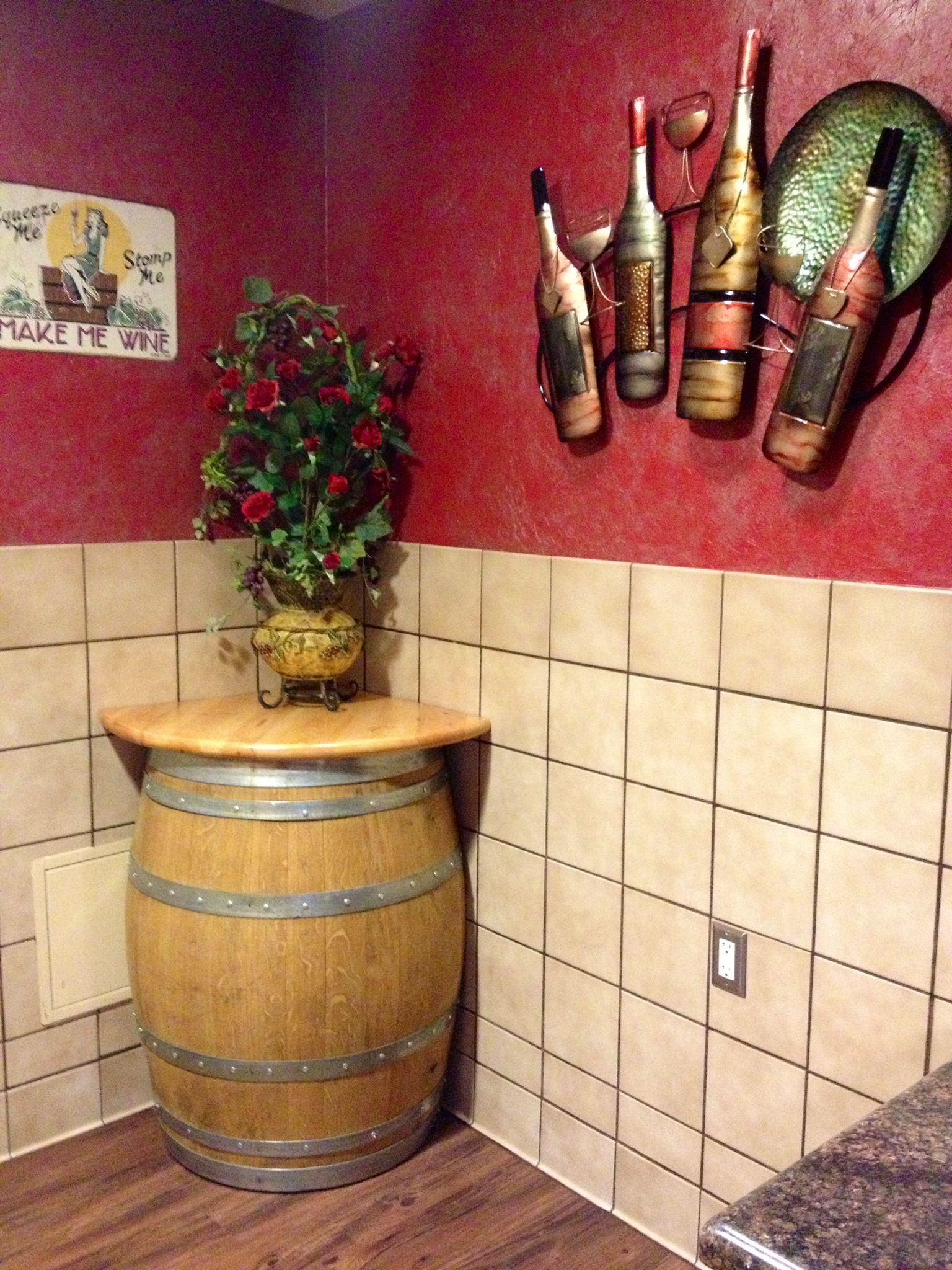 A peek into the women's restroom decorated with an old wine barrel and wine related decor